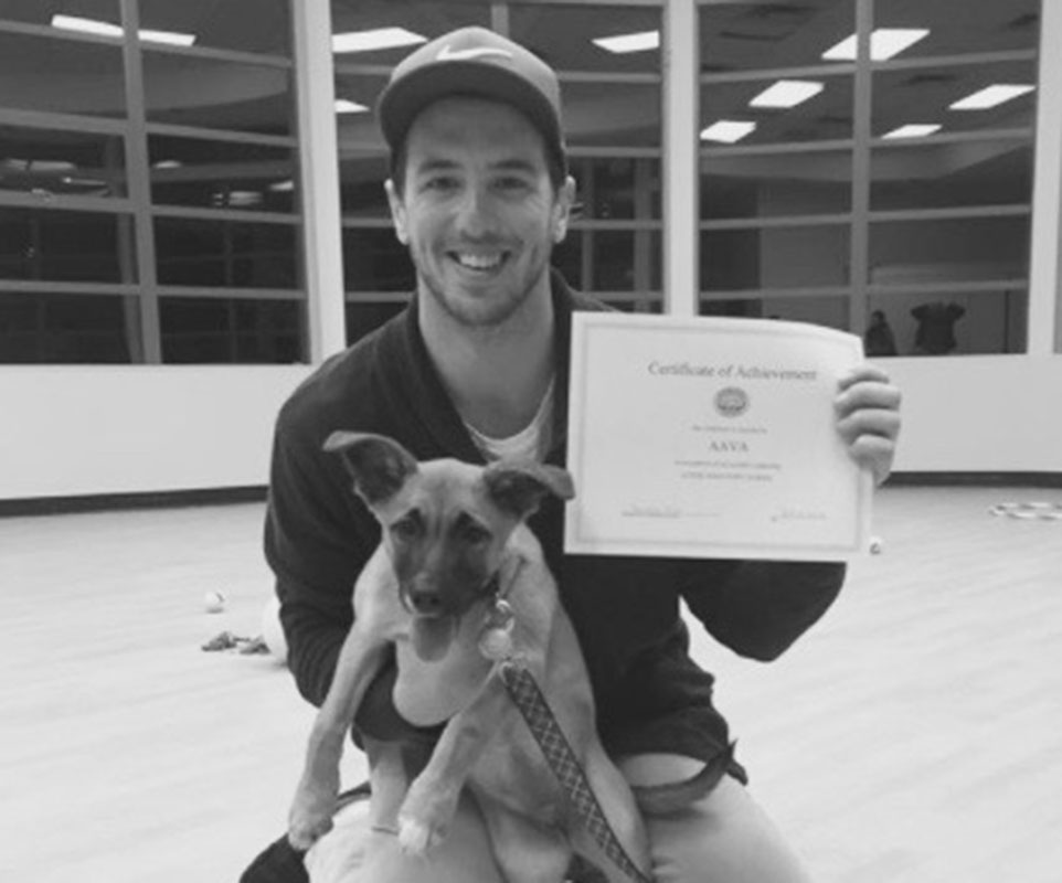 man with dog and certificate