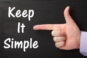 Finger pointing at text that says Keep it Simple